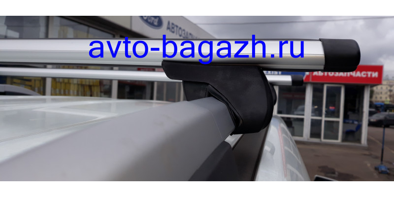 Багажник FAVORIT на рейлинги АЭРО с замком 130 см (Артикул 5511+1106)